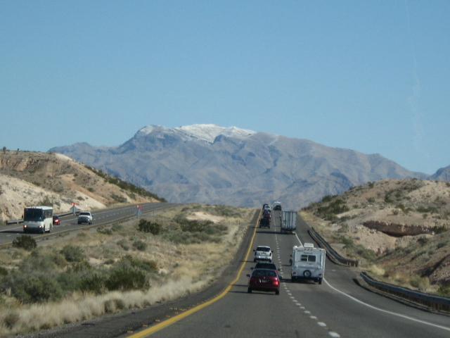 Entering Utah, rhe mountains start and snow appears in the distance.