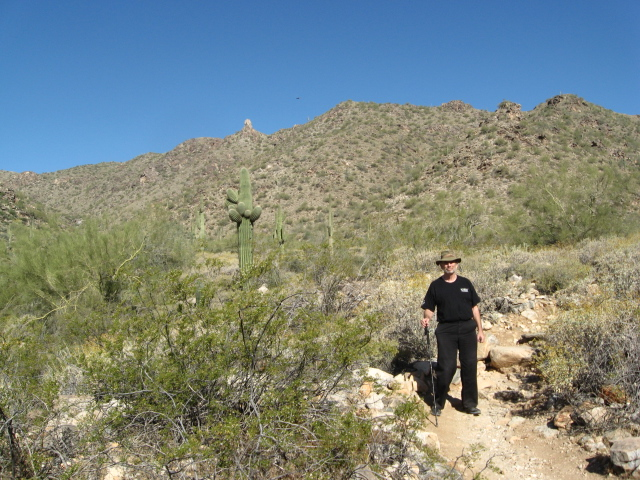 I am a fool to dress this way for a desert walk.  Black is not the color one should wear for an Arizona desert walk, but it isn't too hot yet--mid 80s, and I like black, so I wear it even though I know better.