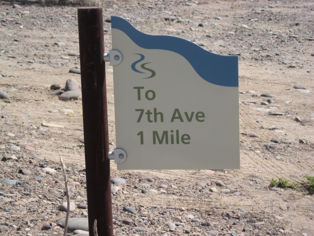 I found another sign.  I still have a mile to walk.  It's 10 a.m. and 100  degrees on the ground, and the bottom of my feet are really sore and tender.